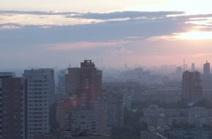 Sunrise over the city. High angle. Aerial view. Blue gray colors.